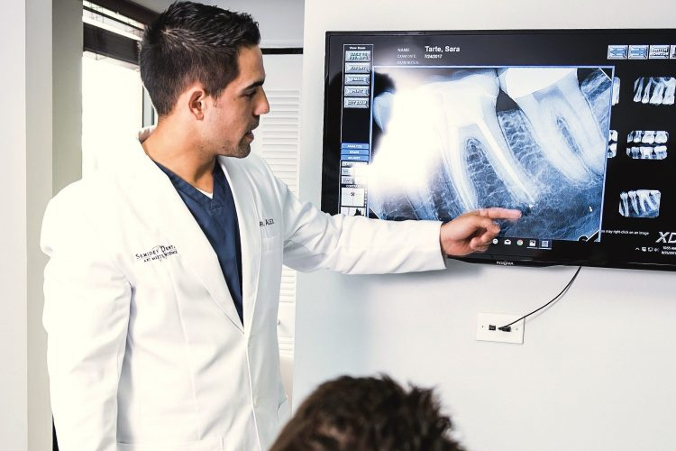 Dr. Alex showing patient her x ray