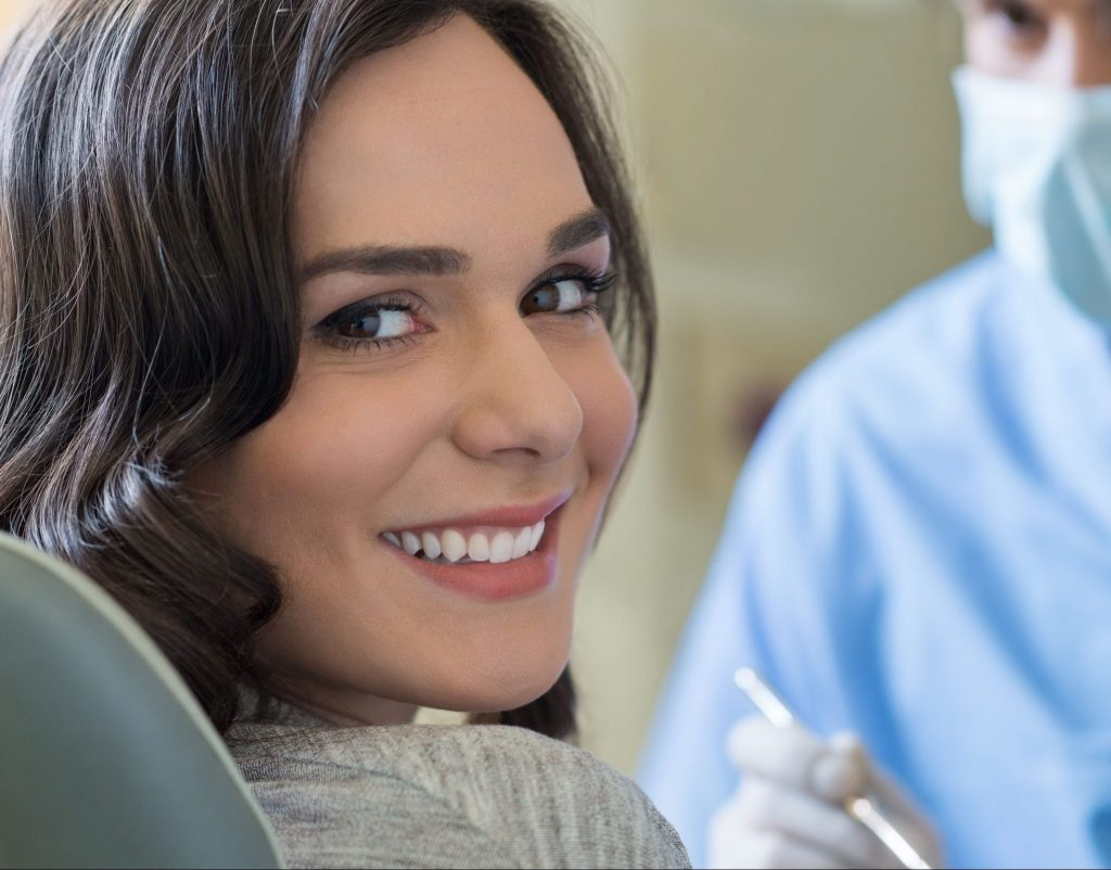 Smiling patient sitting in dental chair